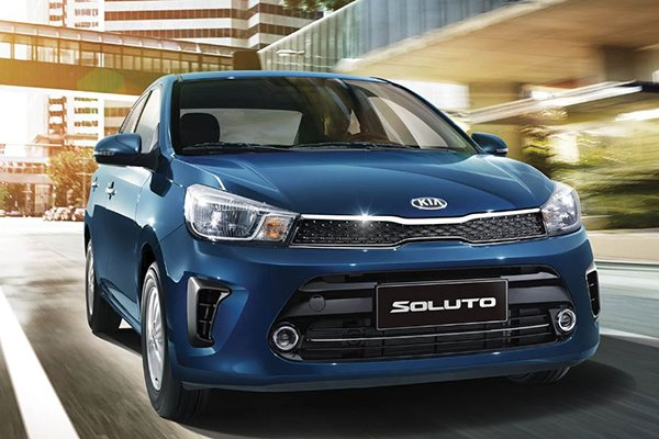 A picture of the Kia Soluto 2019 travelling on a city road