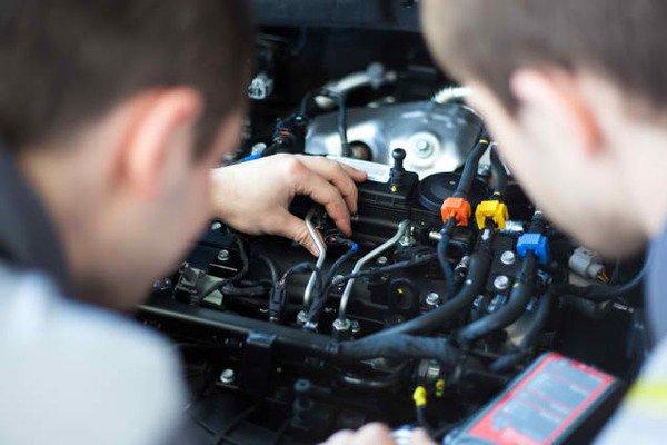 Men inspecting the engine