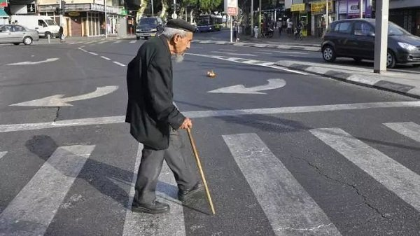 Elderly cross the street