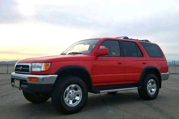 A picture of a red Toyota 4runner