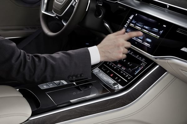 Man touching the infotainment system