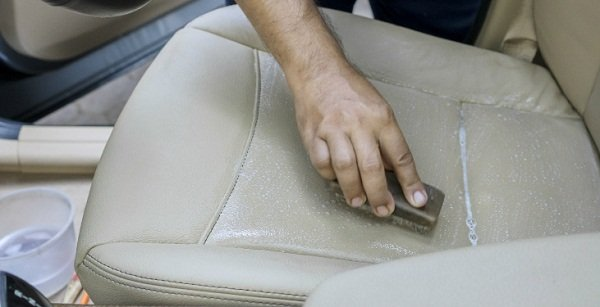 Scrub the car seat