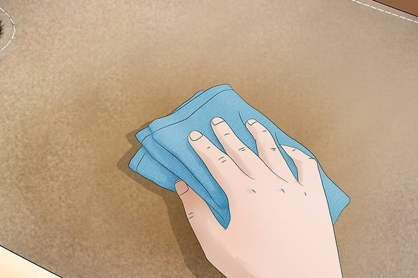 Man wiping the carpet using towel