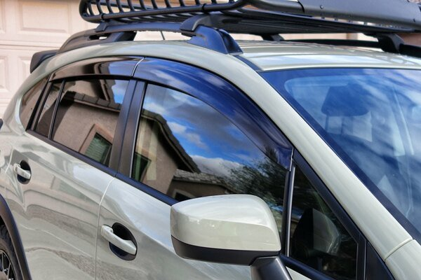 White car with wind deflectors