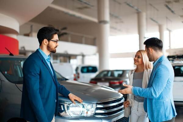 Man talking to a car salesperson