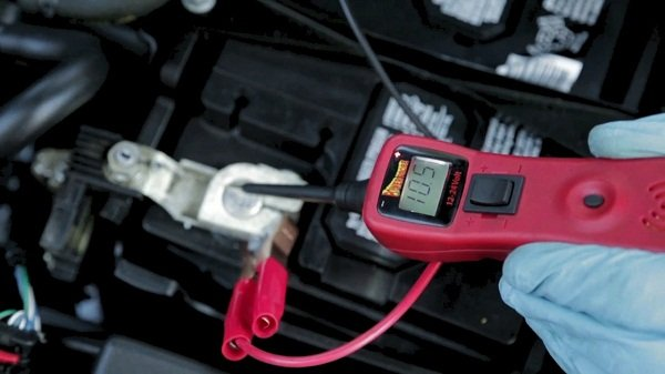 Man checking the voltage of the car battery