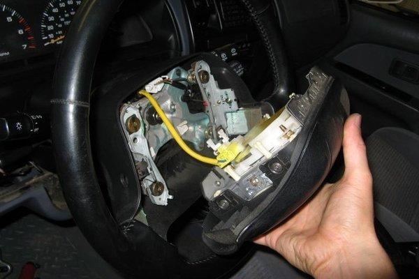 Man fixing the steering wheel