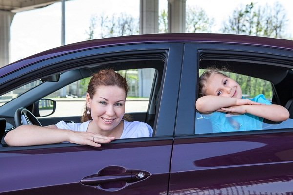 Mom and daughter inside a car
