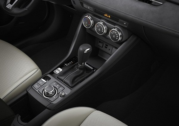 A closeup picture of the center console controls of the Mazda 3