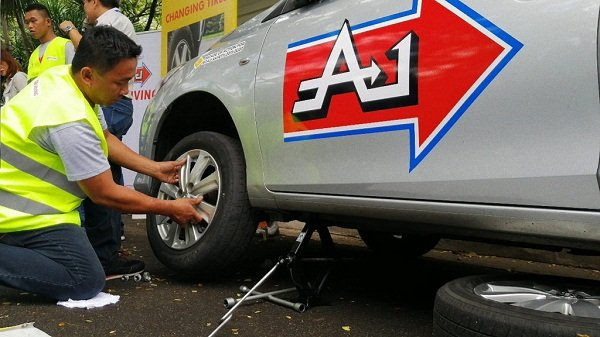 A car maintenance 101 session at A-1 Driving School