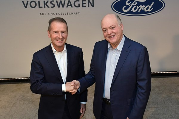 A picture of the Ford and VW ceo's shaking hands