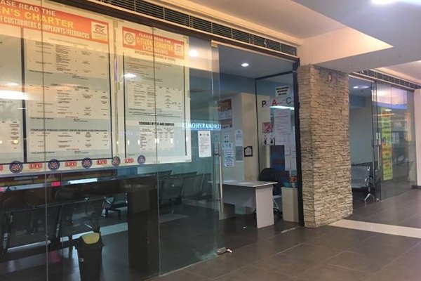 A picture of the front of the LTO renewal center located in SM Seaside Cebu