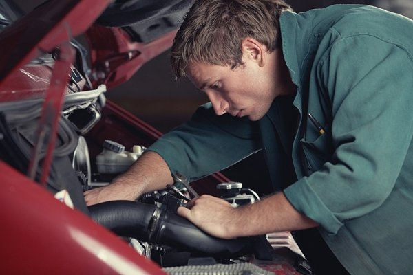 man is checking car engine