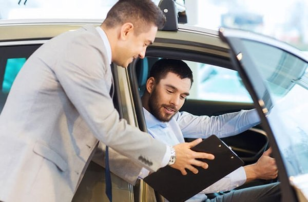 man is buying a car