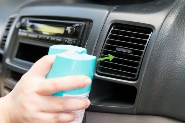 Spraying disinfectant on every vent of your car