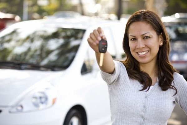 A girl with a new car