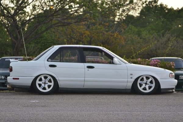 Lowered White Nissan Sentra on road