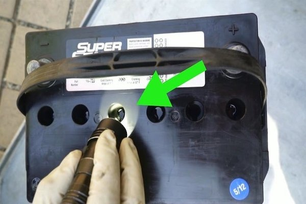 Check the water levels of a car battery