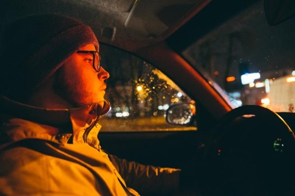 man driving with glasses