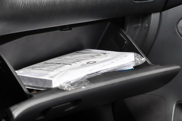 car's manual in the glove compartment