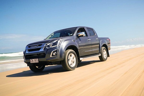 A picture of the 2019 Isuzu dmax on the beach