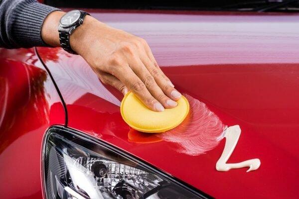 applying wax at the car exterior