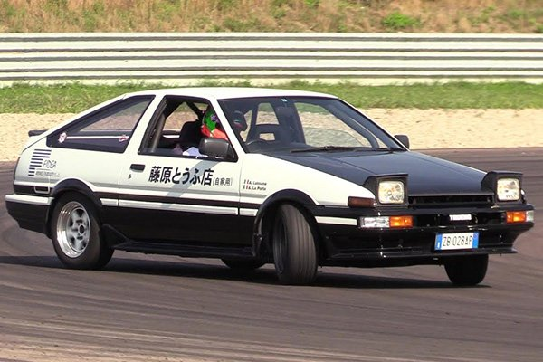 A picture of the 1985 Toyota AE86 Trueno performing a drift
