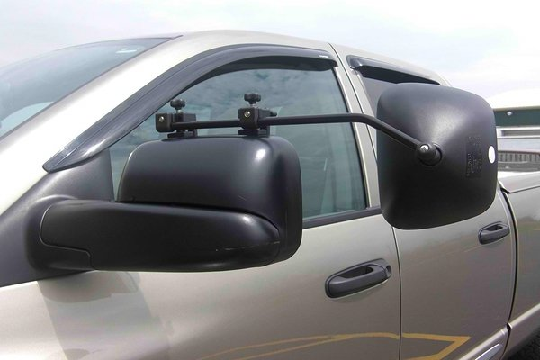 Driving a tow vehicle or truck requires the use of extended side-view mirrors.