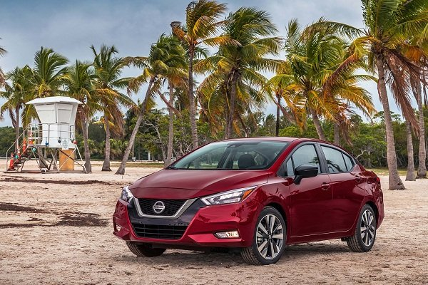 A picture of the 2020 Nissan Almera on a beach