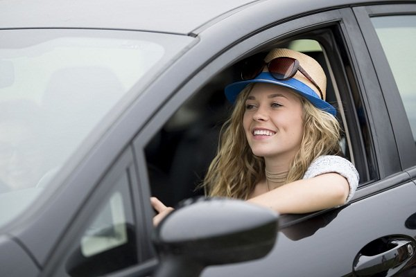 woman driving with the window down