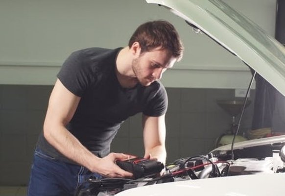 Man checking the car's engine