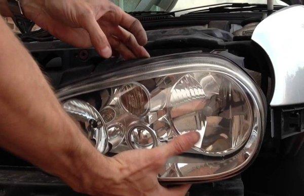 Man holding the car headlight