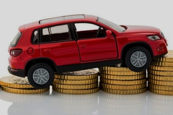 Toy car in coin stack
