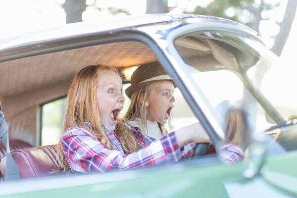 two girls inside the car