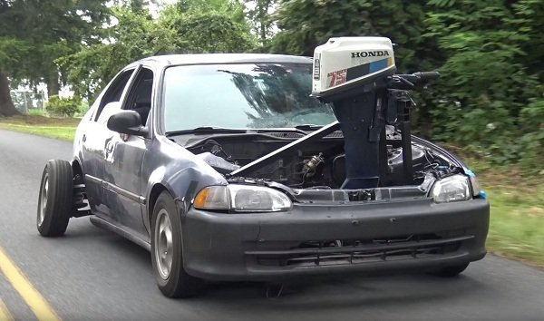 A picture of a 4th gen Honda Civic with an outboard engine