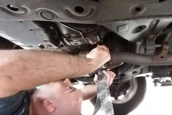 man under the car