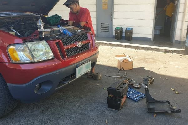 A picture of Mang Danny aka Danknee working on a Ford Explorer Sport Trac