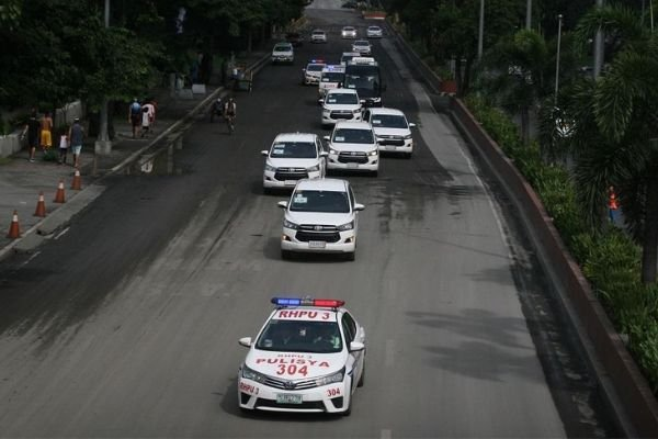 A picture of a convoy with police escorts