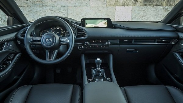 A picture of the front cabin of the Mazda 3