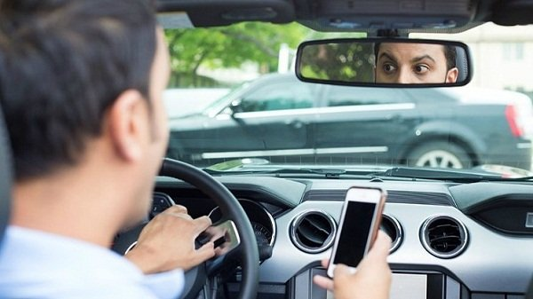 A picture of a distracted driver