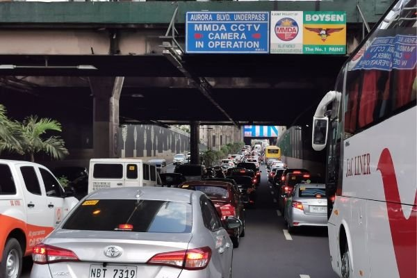 A picture of an overpass in EDSA with a no contact apprehension sign.