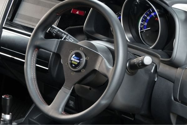 A picture of a car's steering wheel.