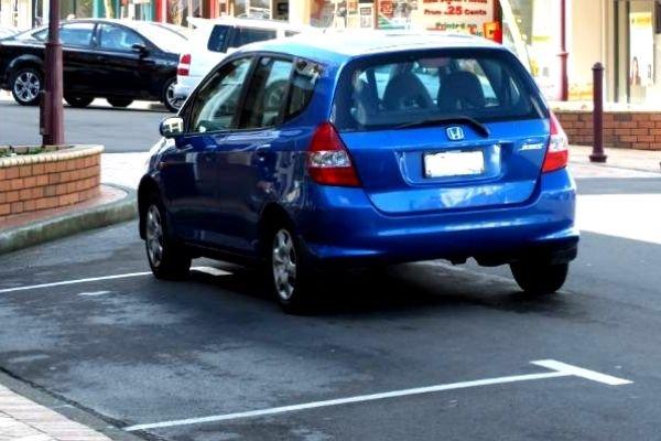 Blue Honda Jazz Parked like a jerk