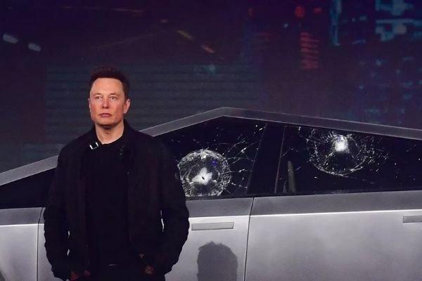 Elon Musk and the Cybertruck with broken windows
