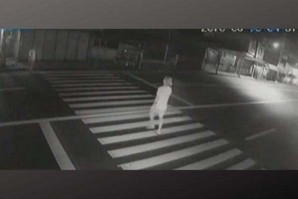 A screenshot of a CCTV shot of a road accident.