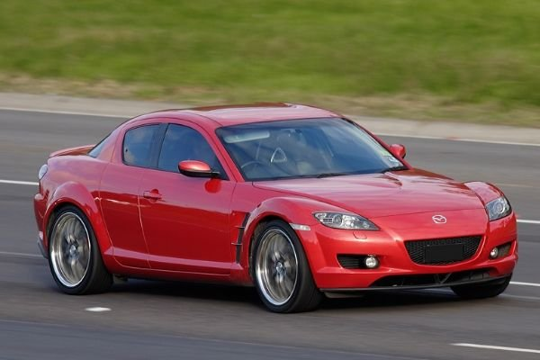 A picture of a Mazda RX8 on a highway.