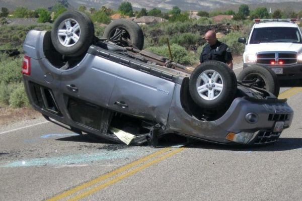A picture of an SUV that had rolled over.