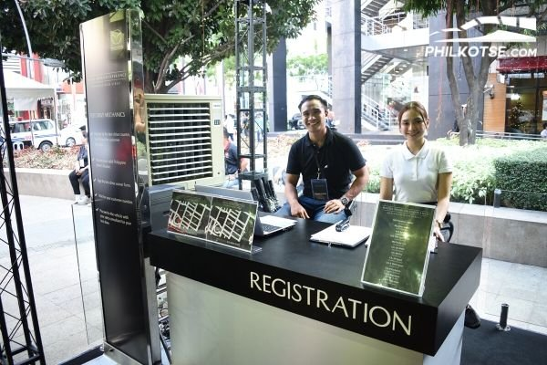 A picture of Mazda staff manning the Premium Experience Pavilion test drive registration booth.