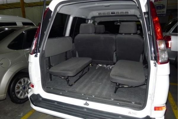 A picture of the Mitsubishi Adventure's interior viewed from the rear.