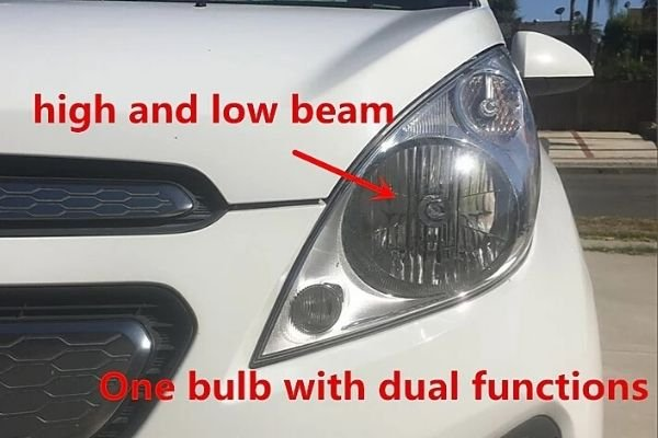 A picture of a car's dual beam headlights.